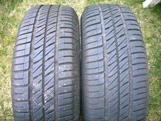 2 pneus montés sur jante