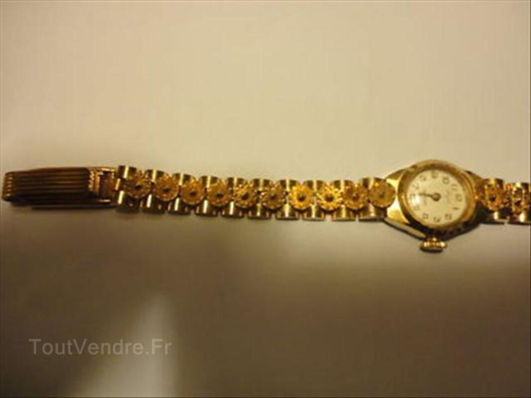 Ancienne montre femme  plaqué or qui fonctionne. 56404189