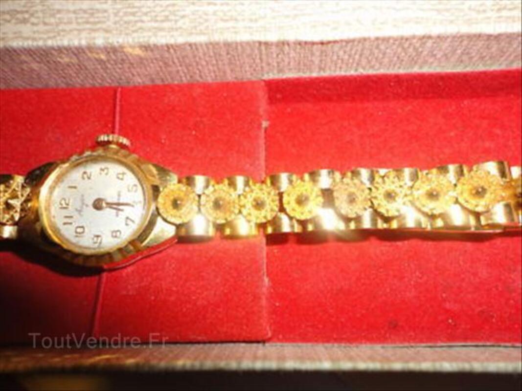 Ancienne montre femme  plaqué or qui fonctionne. 56404190