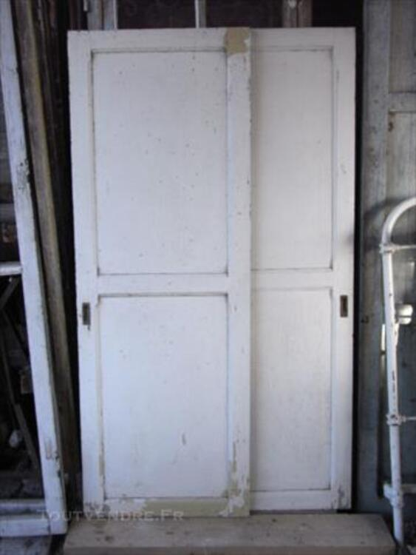 Ancienne porte coulissante en chêne avec ses poignées 84751511