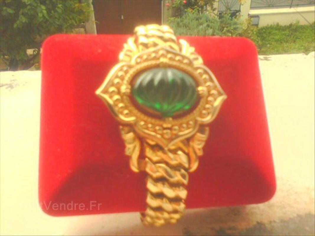 Bracelet plaqué or signé 64638599