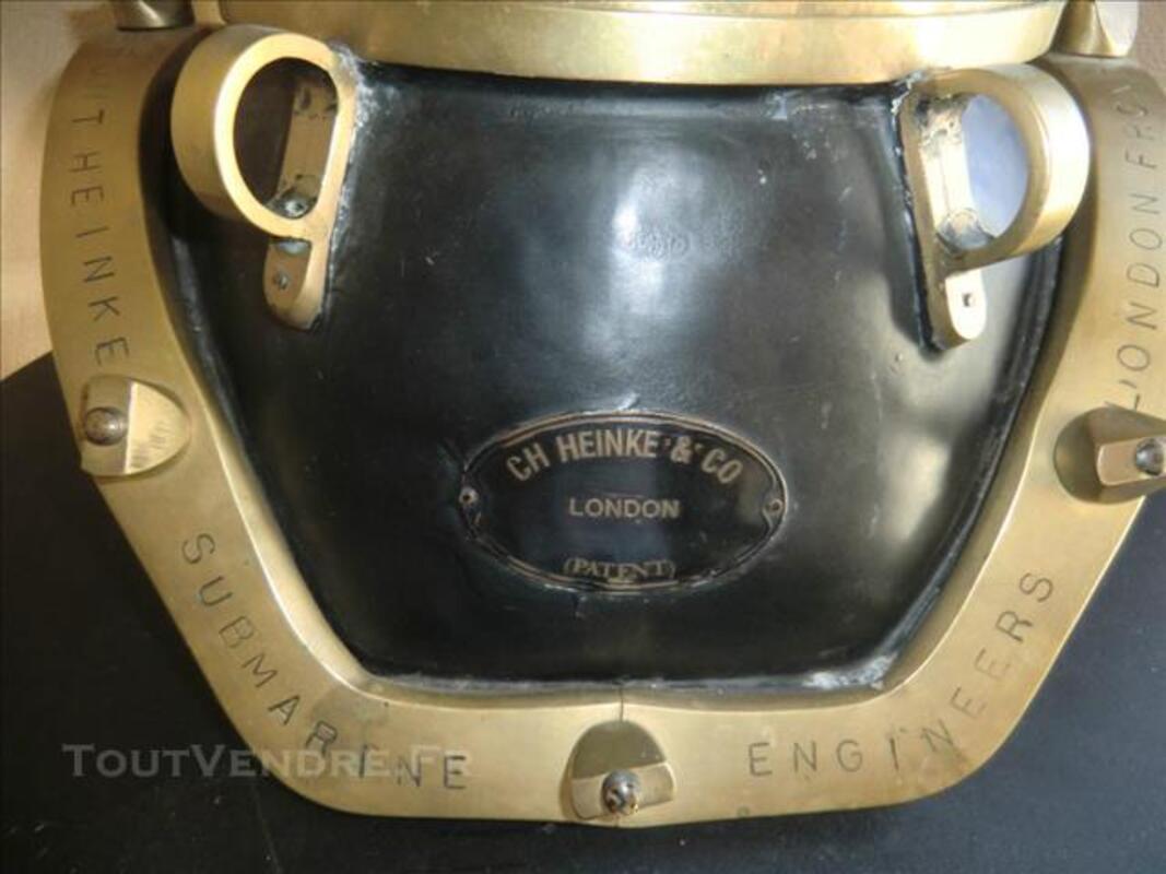 Casque de scaphandrier anglais en cuivre peint. 84556836