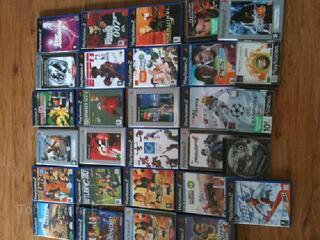 Lot Console PS2 + 2 manettes + caméra eye toy + 29 jeux