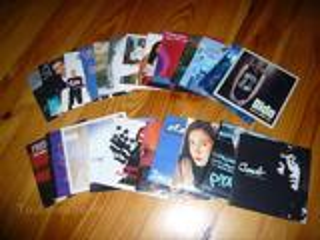 Nombreux CDs deux titres années 2000