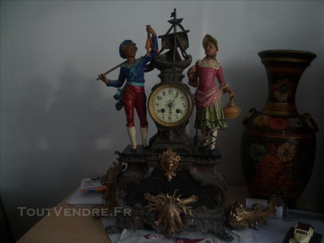 Pendule ancienne en régul style normand 76616037