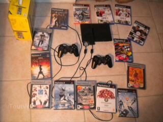 PlayStation 2 + 2 manettes + CM16Mo + 14 jeux