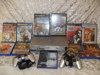 Playstation 2+2manettes+11 jeux + carte memoire
