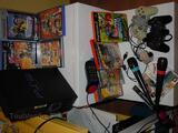 Ps2 ,2 manettes, Eye Toy, Singstar, Buzz et jeux