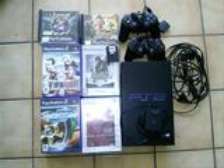 PS2 TBE + ACCESSOIRES + 2 MANETTES + CARTE  16 MB +JEUX