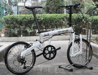 Vélo pliant neuf, r 20p suspendues, ultra léger 8,9 Kg!